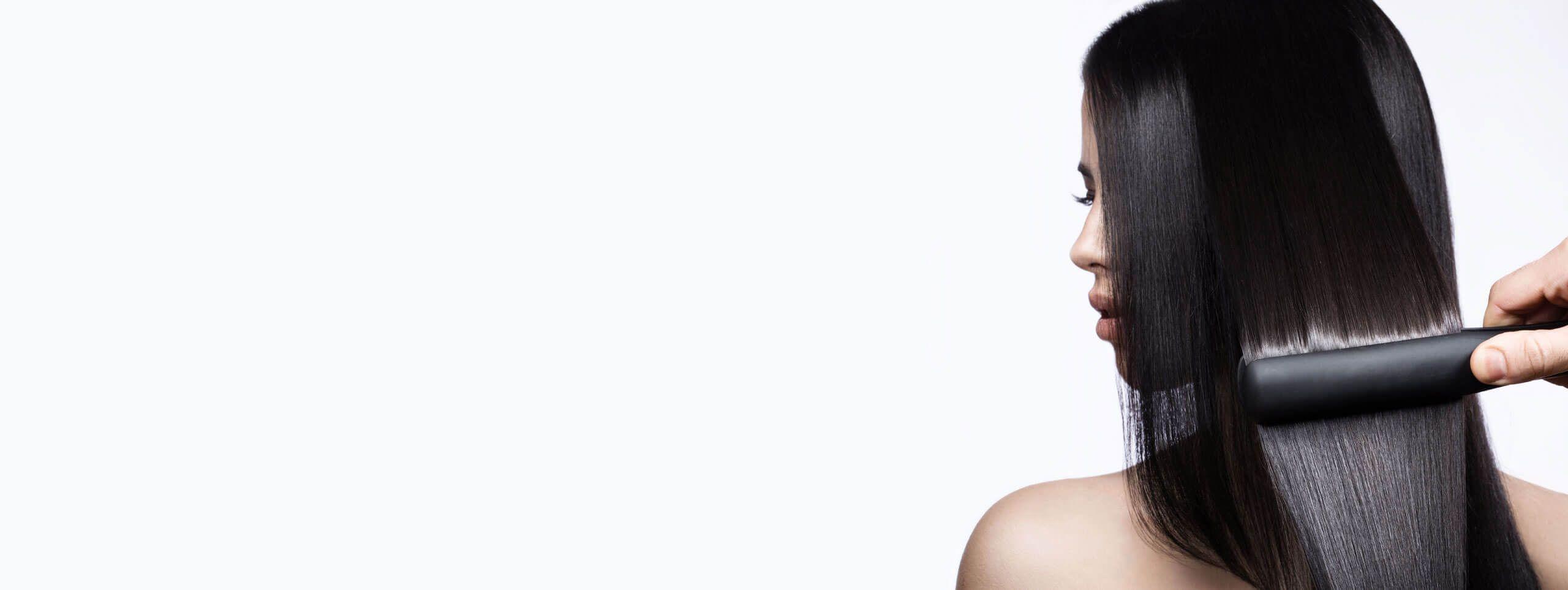 Разглаживание волос термоутюжок