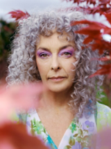 Essential Looks Natural Curls Model With White and Purple Hair