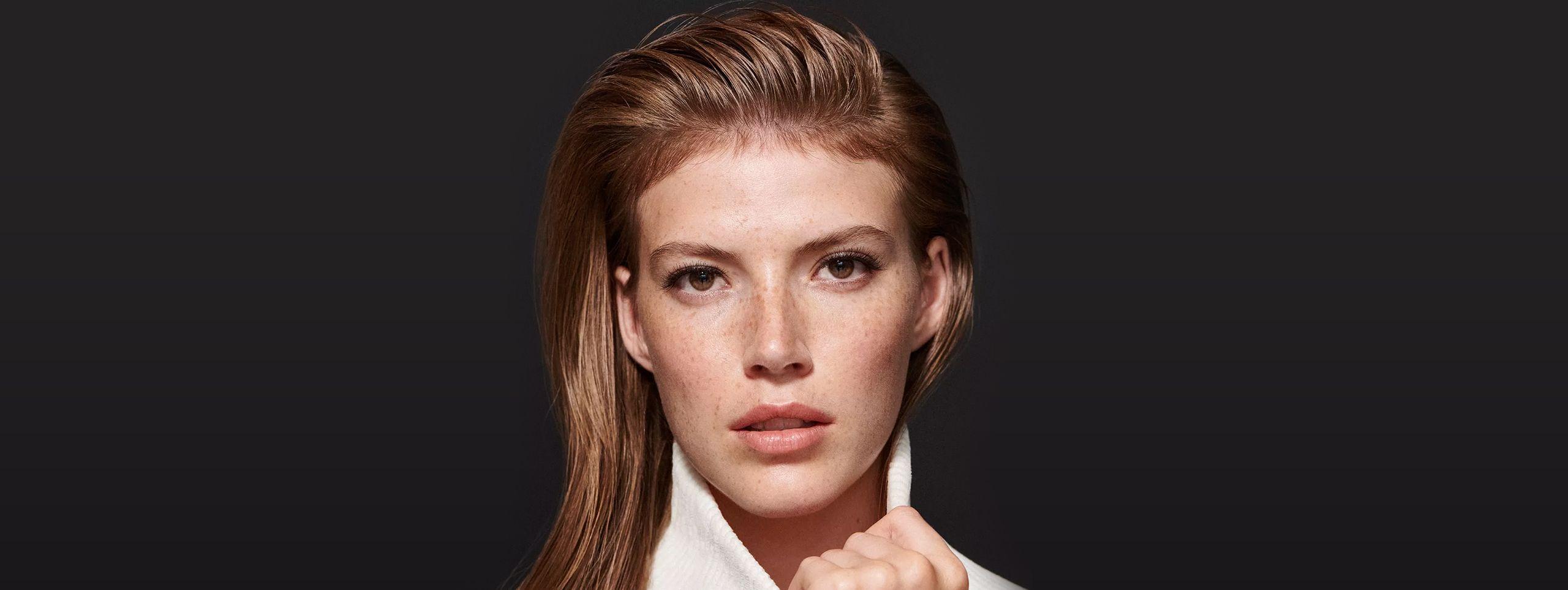 Woman with long sleek hair. Wet look.