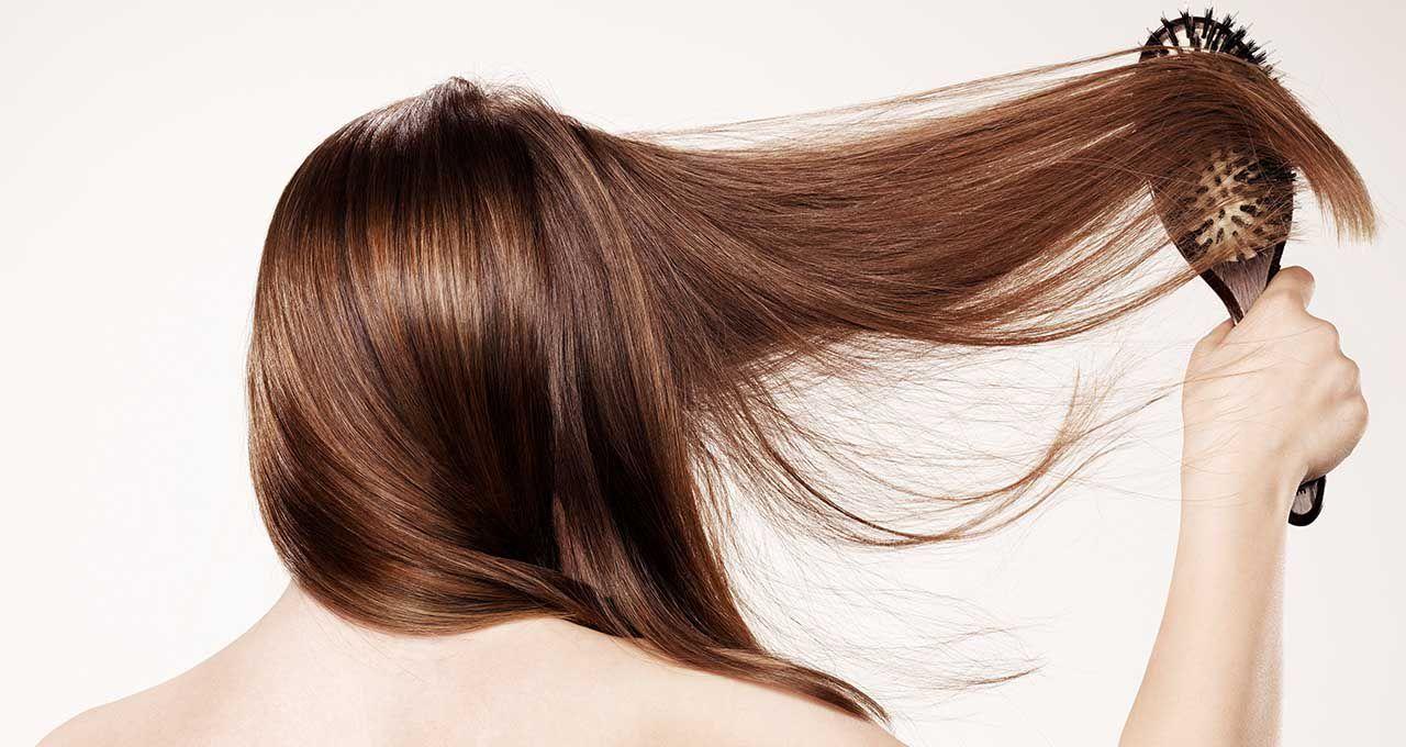 Brunette woman brushing her hair