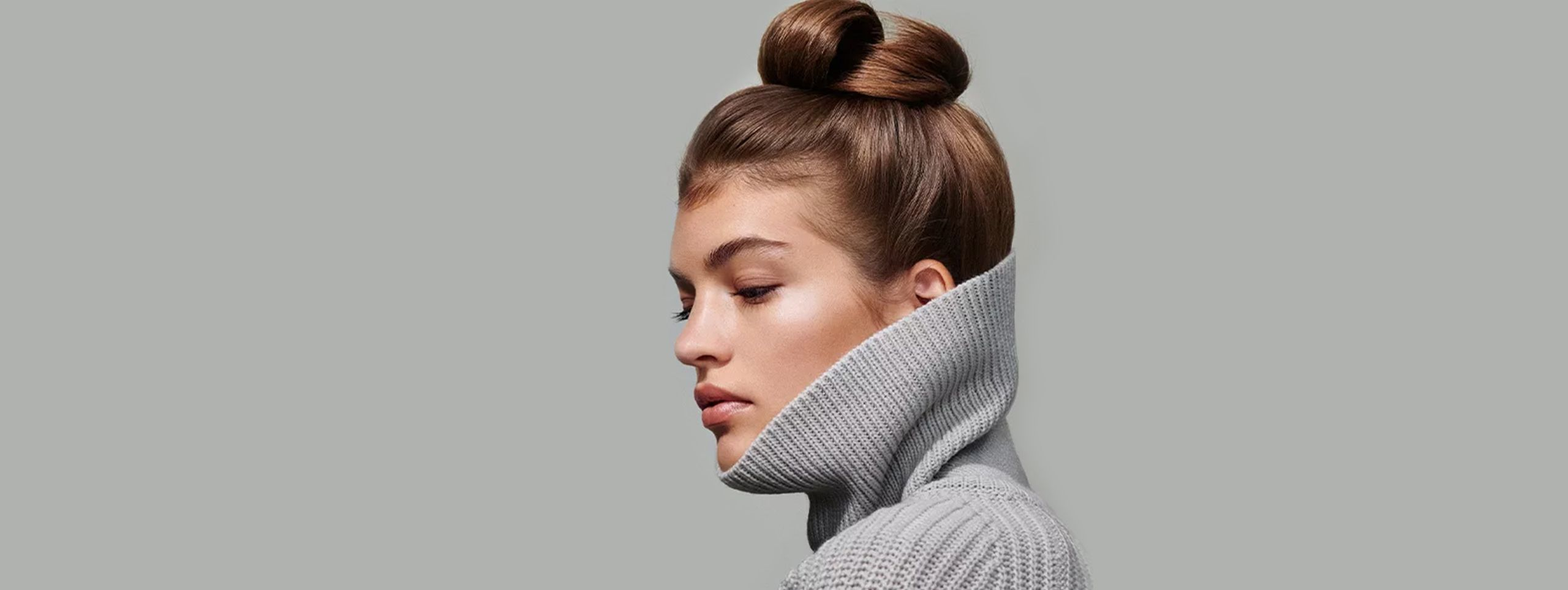 Side view of woman with hair up
