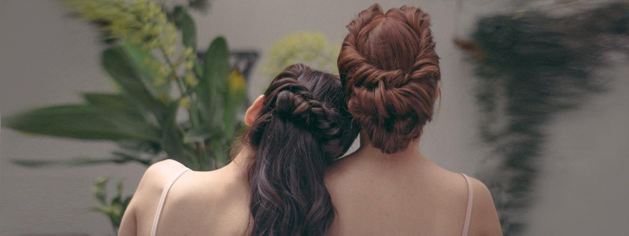 Two women with prom hairstyles