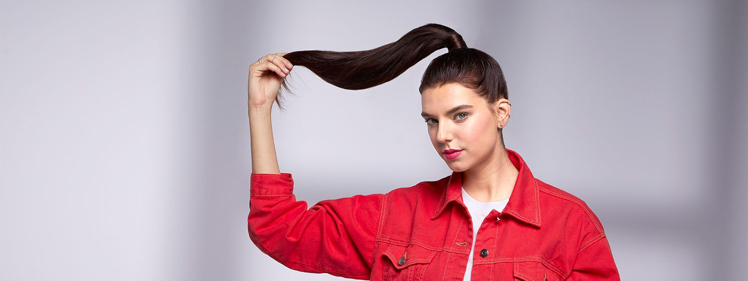 Woman holding the end of her long ponytail