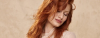 Beautiful young woman with long red hair