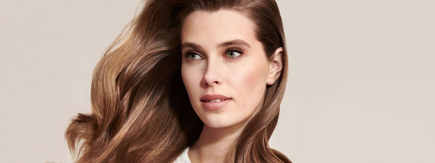 Woman with healthy looking brunette hair flowing around her