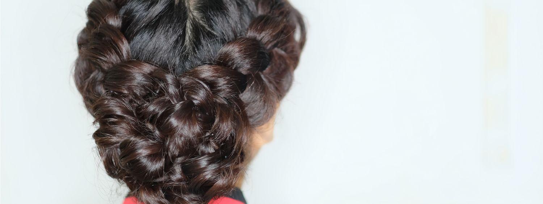 Vue de dos sur une femme brune avec deux tresses hollandaises