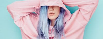girl with blue hair pink sweatshirt
