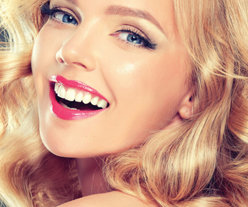 Woman with beautiful strawberry blonde hair, a popular hair color trend for women