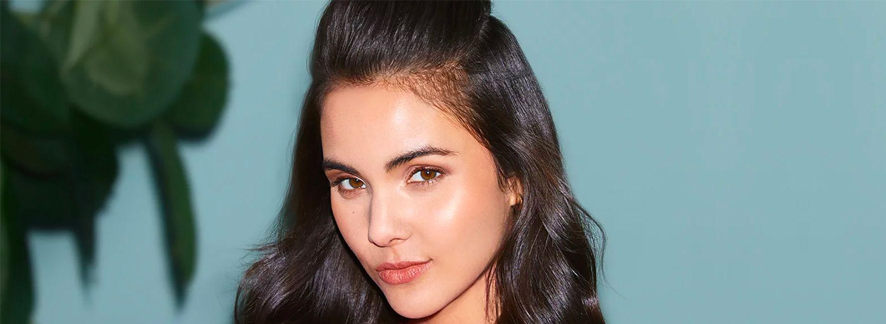 Woman with dark half ponytail hairstyle