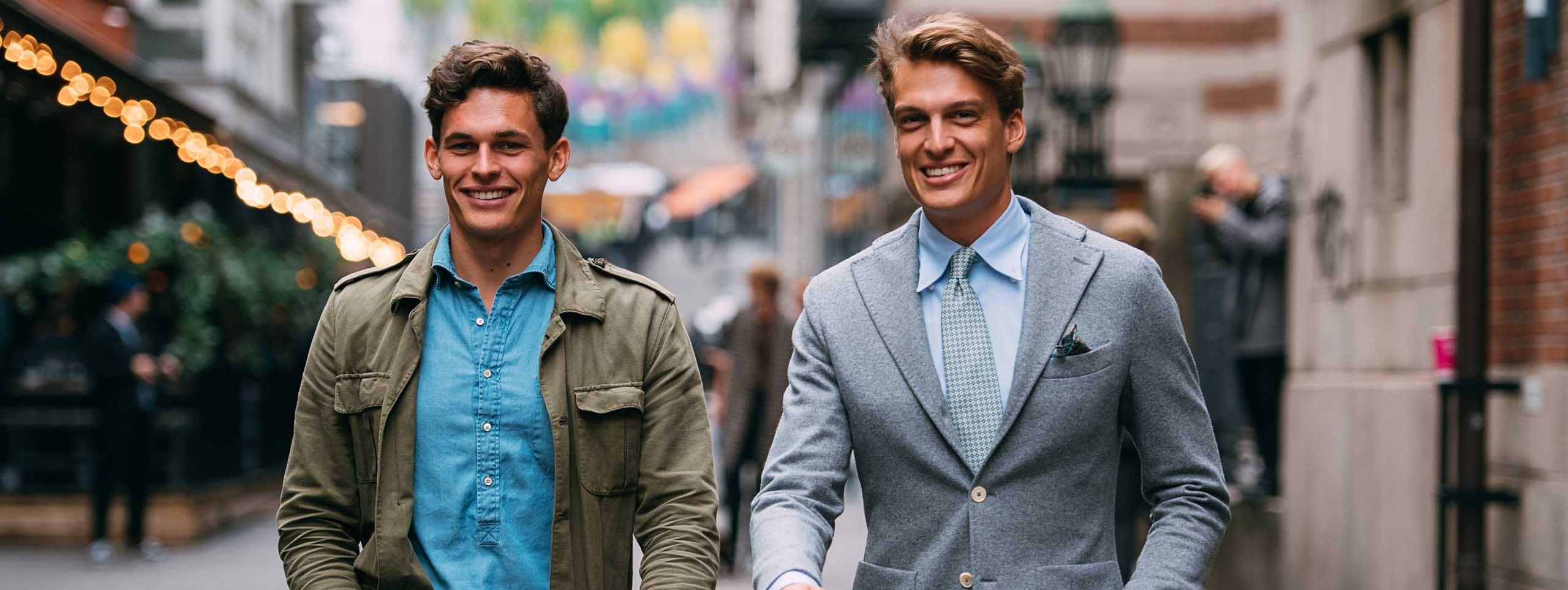 Dva muškarca u poslovnoj odjeći s poslovnim frizurama
