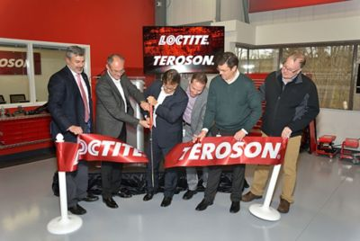 Leaders from the Henkel's General Industry division cut the ribbon to officially open the new customer training center.