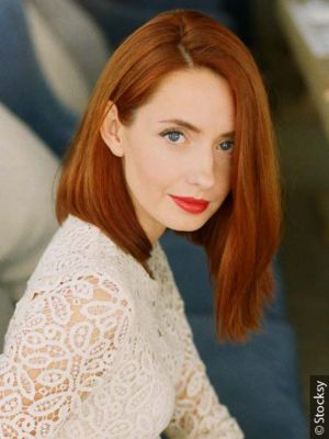 Red-haired woman with graduated bob