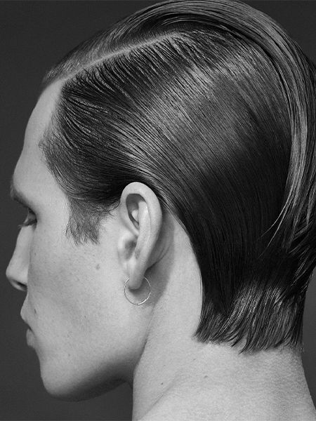 Black and white image of man with slicked back hair