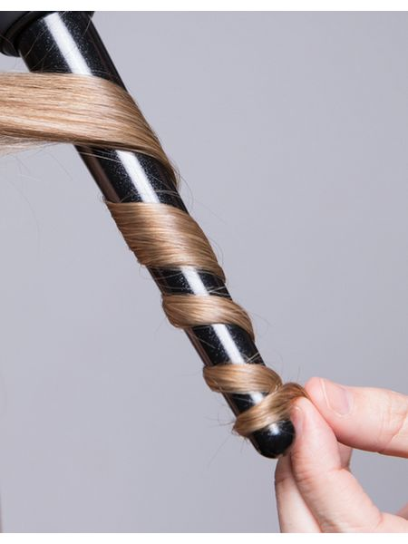 Hair wrapped around a 9-18mm curling wand