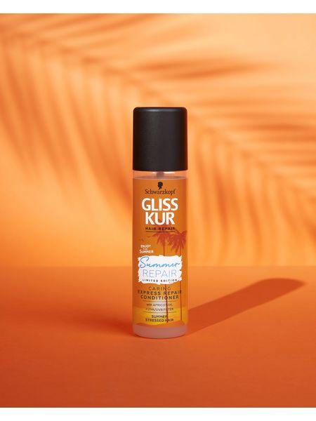 Bottle of Gliss Summer Repair Express Repair Conditioner with orange background