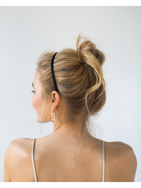Woman with messy bun hairstyle and hair band
