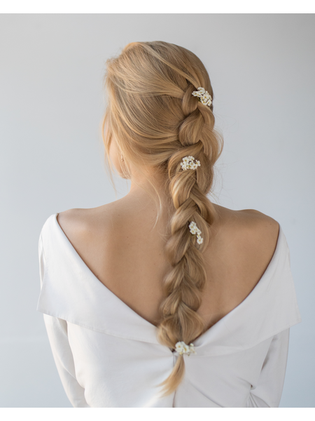 Woman with romantic hairstyle, wearing wedding dress