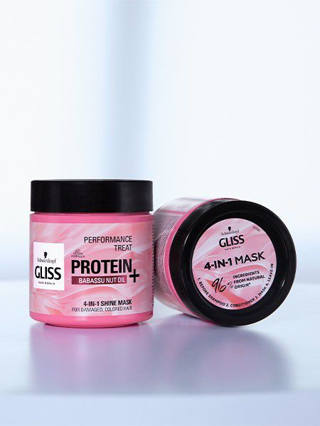 The pink packaging containing the Gliss 4-in-1 hair mask.