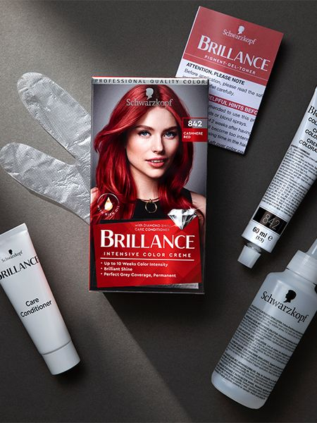 Box of Brillance hair color surrounded by its contents