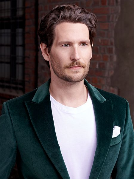 Brunette man wearing a green velvet suit