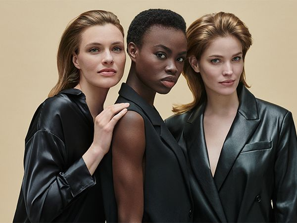 Profile view of three women looking confidently in front of them