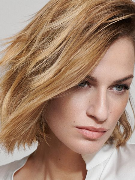 Woman with newly-dyed blonde hair and smoldering look