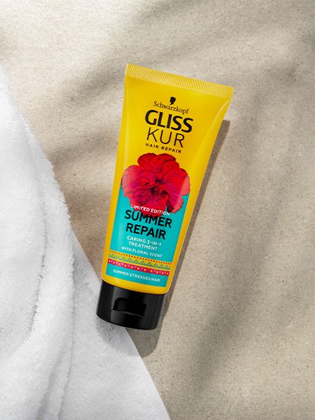 Gliss Kur Summer Repair Caring 3-in-1 treatment lies on a white towel and beige surface