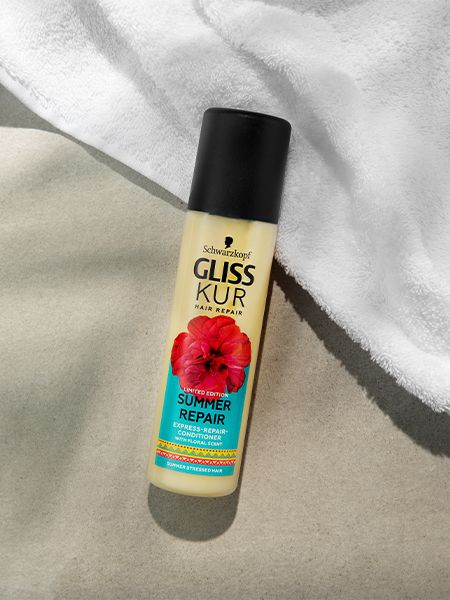 Gliss Kur Summer Repair Express Repair Conditioner lies on a white towel and beige surface