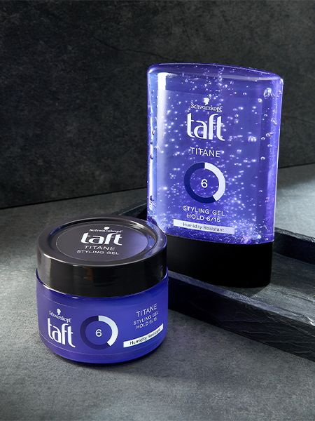 Two Taft Titane styling gel products displayed with a gray background