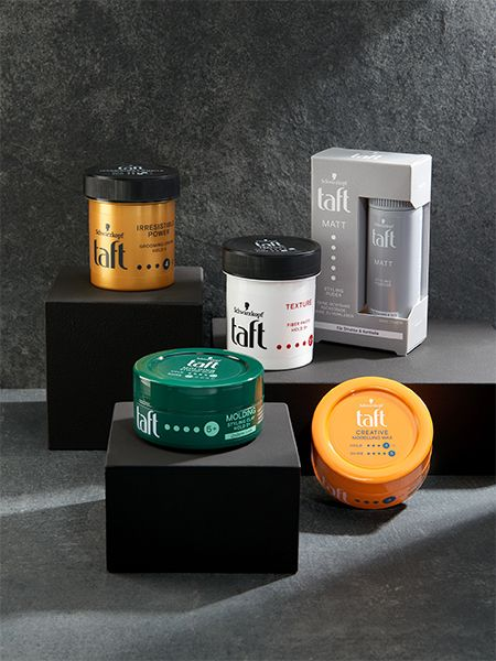 Five different Taft styling products displayed on black boxes with gray background