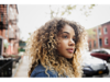Woman with curly hair in the street