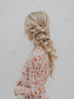 Woman with blonde braided prom hair