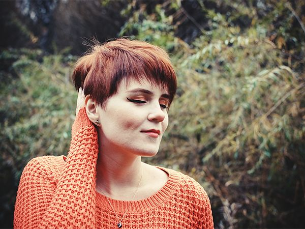 Woman with short red hair with lots of volume