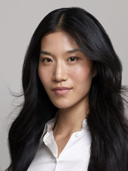 Woman with healthy black hair and wearing a white shirt