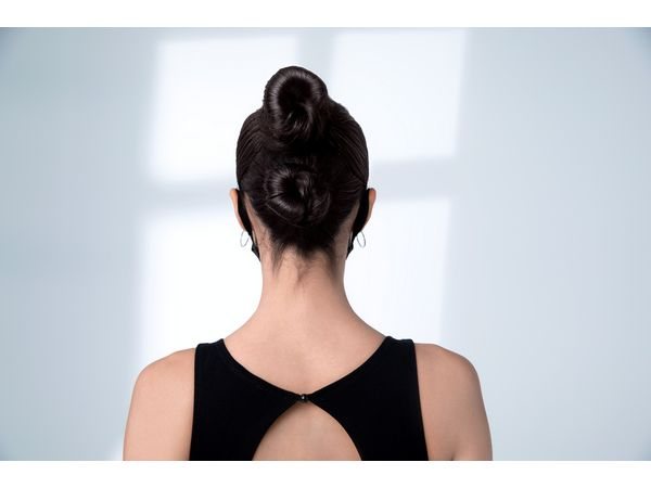Woman with black hair in double buns
