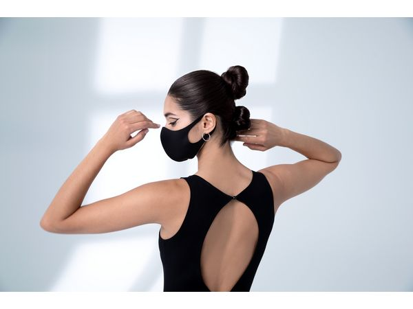 Woman with double buns wearing a face mask