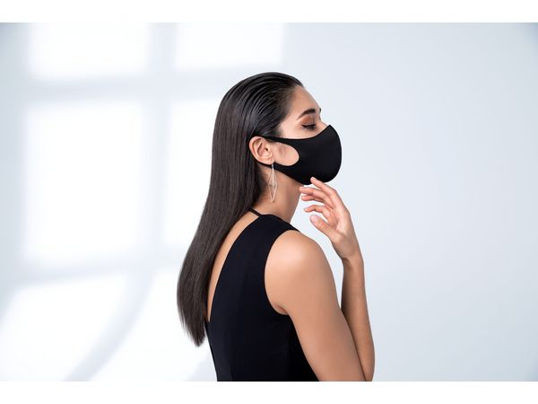 Woman with sleek hair and wearing a face mask