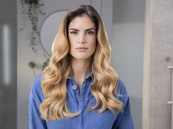 Woman with healthy looking hair looking at the camera