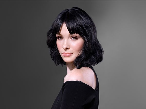 Black-haired woman with fresh, styled hair