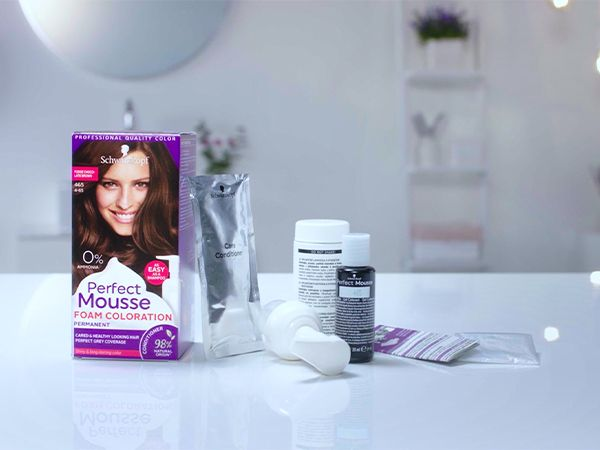 Box of Perfect Mousse hair color surrounded by its contents