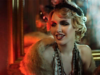 Woman dressed as a flapper girl in dimly lit room with orange hue