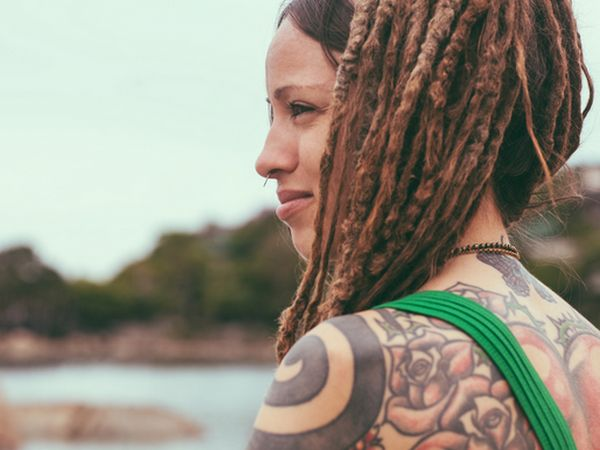 Brunette woman with dreadlocks and lots of tattoos