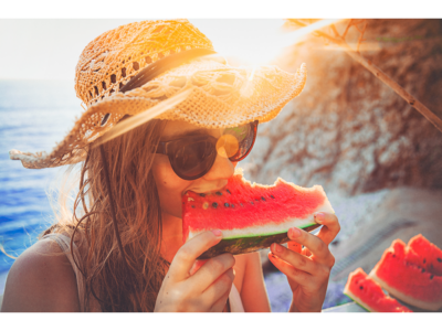 Woman eating watermelon in the sun