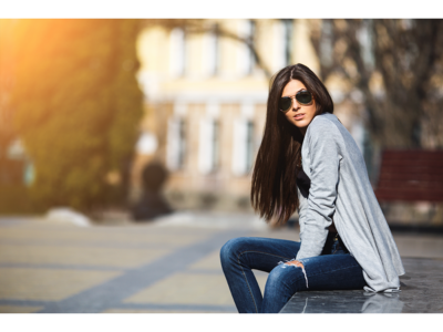 Woman with shiny, healthly hair sitting down outside