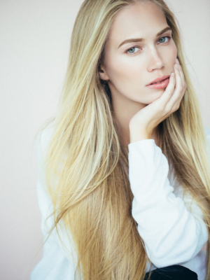 Woman with long blonde hair - very sleek