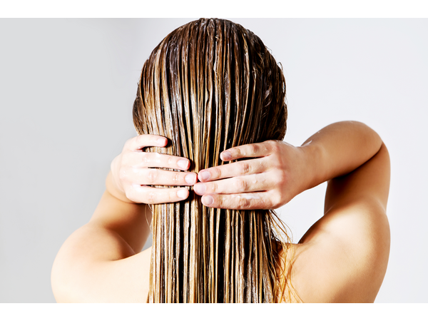 Woman with back to the camera and wet hair