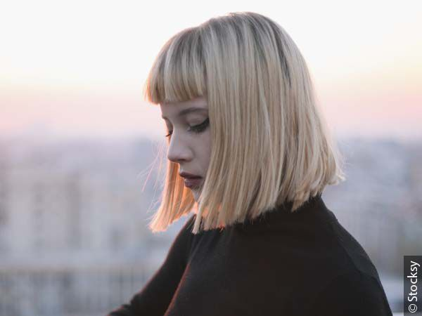 Blonde girl with bangs and bob hairstyle