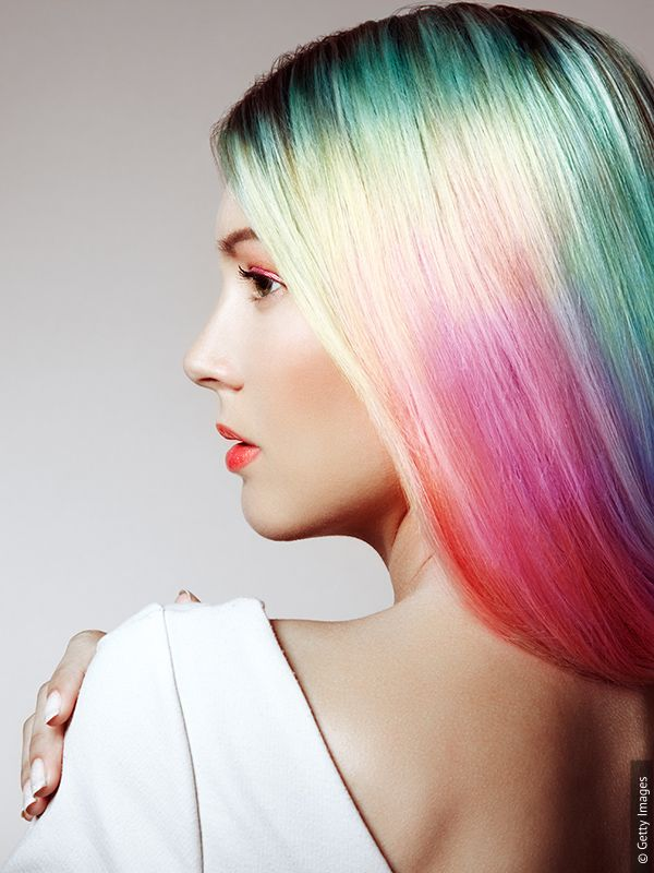 Woman with multicolored hair - green, pink and purple