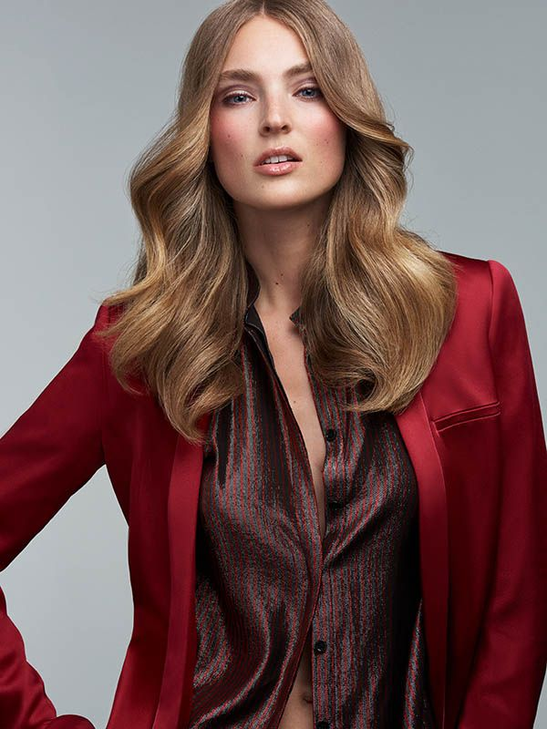 Elegant evening style with long hair worn down.