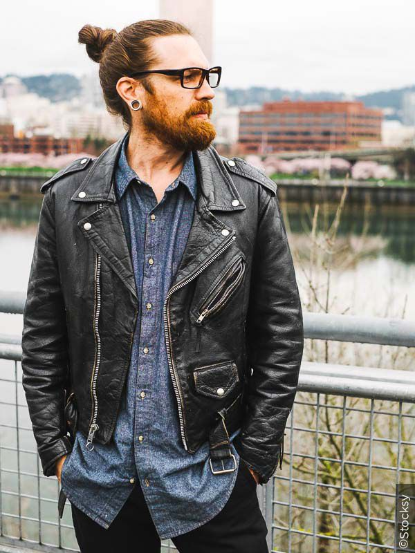 Leisurely man bun with leather jacket and jeans.
